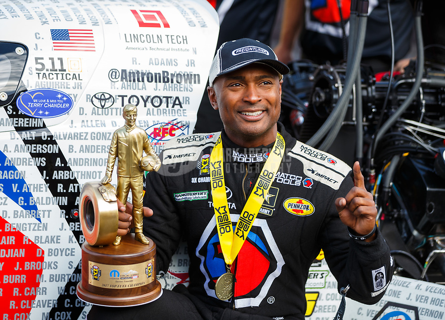 Jul 23, 2017; Morrison, CO, USA; NHRA top fuel driver Antron Brown celebrates after winning the Mile High Nationals at Bandimere Speedway. Mandatory Credit: Mark J. Rebilas-USA TODAY Sports