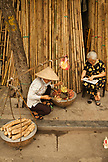 VIETNAM, Hanoi, a street vendor sells root vegetables on bamboo street in the old quarter