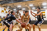 WATERBURY, CT. 09 January 2020-010920BS212 - Wolcott Tech's Mike Cappetto (20), left, tries to steal the ball away from Kaynor Tech's Michael Morales (22), center, as Wolcott Tech's David Sidoti (21) blocks his way on the right, during a Boy Basketball game between Wolcott Tech and Kaynor Tech at Kaynor Tech in Waterbury on Thursday. Bill Shettle Republican-American