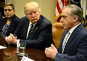 United States President Donald Trump (C) listens to remarks by Veteran's Administration Secretary David Shulkin during a meeting on Veteran's Affairs in the Cabinet Room of the White House, March 17, 2017, in Washington, DC. Trump's budget proposal requests an increase in spending for the VA.    <br /> Credit: Mike Theiler / Pool via CNP