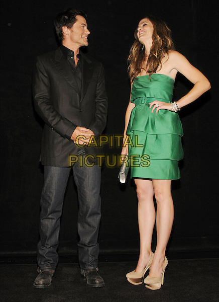 "ROB LOWE & JENNIFER GARNER .""The Invention of Lying"" After Party held at The Elgin during the 2009 Toronto International Film Festival, Toronto, Ontario, Canada, 14th September 2009..full length black suit jacket jeans denim green tiered strapless layered dress clutch bag beige gold platform shoes silk satin high heels waist belt hand on hip.CAP/ADM/BPC.©Brent Perniac/Admedia/Capital Pictures"