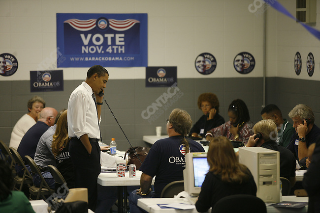 Democratic Presidential candidate Barack Obama visits a United Auto Workers hall on election day, where union members work telephones to get out the vote. Indianapolis, Indian, November 4, 2008