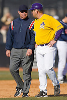 East Carolina Pirates head coach Billy Godwin #28 discusses a call with first base umpire Stan Johnson at Clark-LeClair Stadium on February 20, 2010 in Greenville, North Carolina.   Photo by Brian Westerholt / Four Seam Images