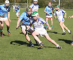 1310/2015   Action from Sixmilebridge where Sr Flannen's College took on Castletroy College in the Harty Cup.  Our photograph shows Stephen Collins, St Flannans trying to get out of a pending tackle from Conor Nicholas.<br />
