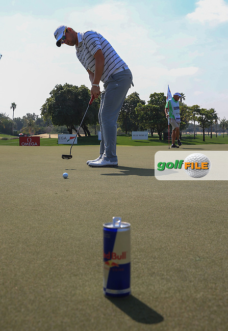 Practice putting to the Redbull can is Bernd Wiesberger (AUT) during the Pro-Am at the 2016 Omega Dubai Desert Classic, played on the Emirates Golf Club, Dubai, United Arab Emirates.  03/02/2016. Picture: Golffile | David Lloyd<br /> <br /> All photos usage must carry mandatory copyright credit (&copy; Golffile | David Lloyd)