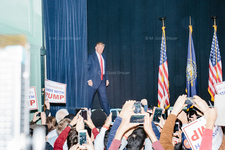 Real estate mogul and Republican presidential candidate Donald Trump takes to the stage at a rally at Exeter Town Hall in Exeter, New Hampshire, on Thurs., Feb. 4, 2016.