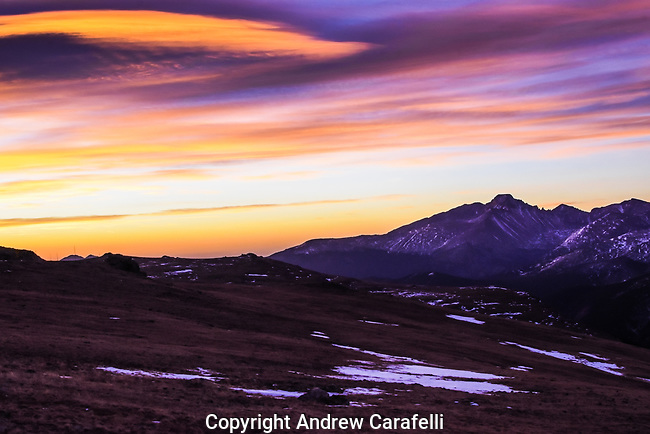 The morning sky above 14, 259 foot high Long's Peak in Rocky Mountain National Park is set on fire by the rising sun.