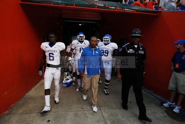 "UK head coach Joker Phillips takes the field with the team before the first half of the UK vs Florida football game at the ""Swamp"" on Saturday, Sept. 25, 2010 Photo by Britney McIntosh 