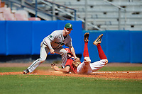 Dartmouth Big Green third baseman Steffen Torgersen (29) tags Keaton Rice (15) sliding in safely during a game against the Bradley Braves on March 21, 2019 at Chain of Lakes Stadium in Winter Haven, Florida.  Bradley defeated Dartmouth 6-3.  (Mike Janes/Four Seam Images)