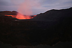 San Pedro crater with glowing Santiago Crater illuminated by lava lake behind on erupting Masaya Volcano, Nicaragua