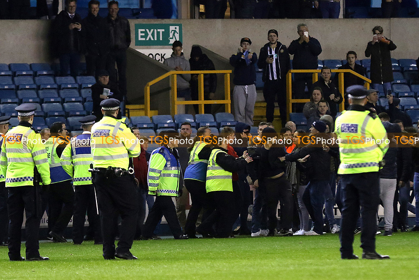 Millwall stewards try to calm down some Millwall supporters after they invaded the pitch at the final whistle during Millwall vs Scunthorpe United, Sky Bet EFL League 1 Play-Off Football at The Den on 4th May 2017