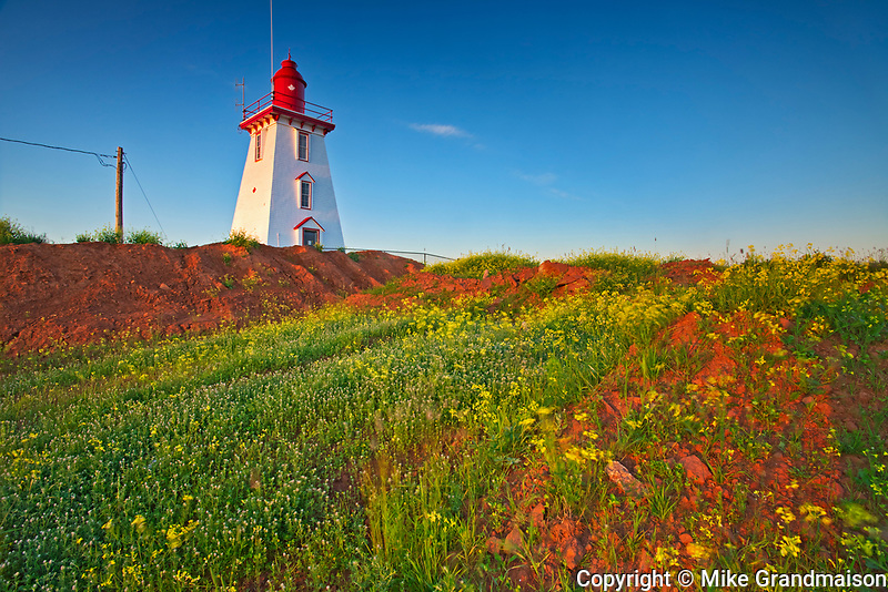 Souris East Lighthouse (historic)  above the cliff on Knight Point. sunrise<br />Souris<br />Prince Edward Island<br />Canada