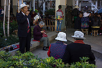 "An elderly man sings at a park in Gejiu, November 2014. Gejiu in Yunnan province is a ""Tin Centre"" with more than 2,000 years of mining history. Tin articles made in Gejiu are highly acclaimed in China. However, the tin mining and related industries are in decline."