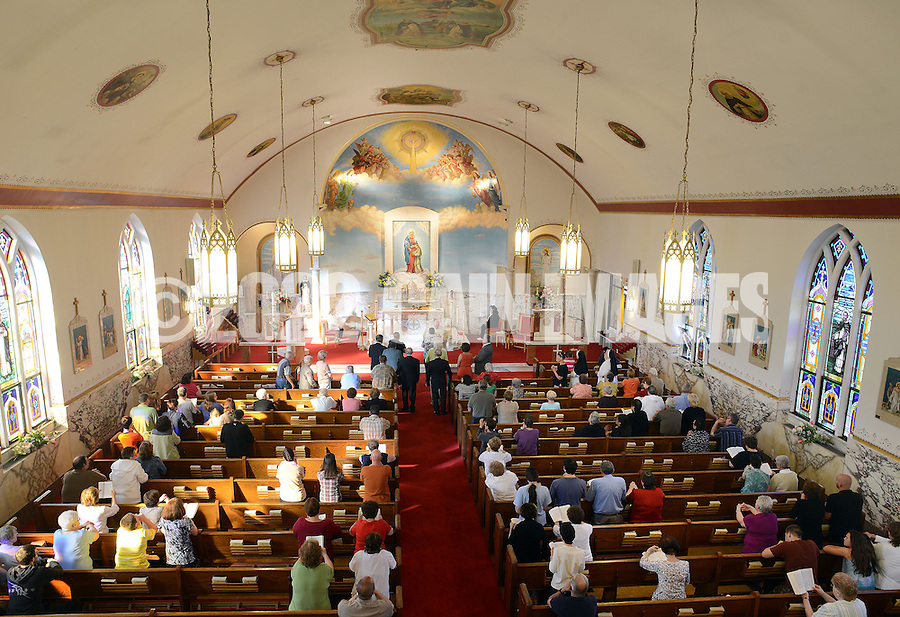 BRISTOL, PA - MAY 31:  Parishioners receive Holy Communion during mass after the closing of St. Ann's parish is announced May 31, 2014 in Bristol, Pennsylvania. (Photo by William Thomas Cain/Cain Images)
