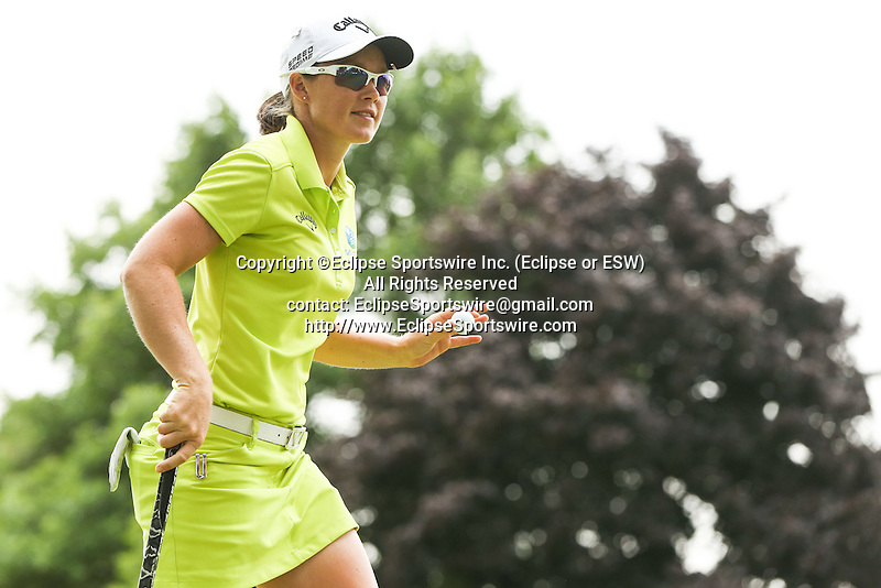 Stacey Keating waves to the fans on the 9th green at the LPGA Championship 2014 Sponsored By Wegmans at Monroe Golf Club in Pittsford, New York on August 16, 2014