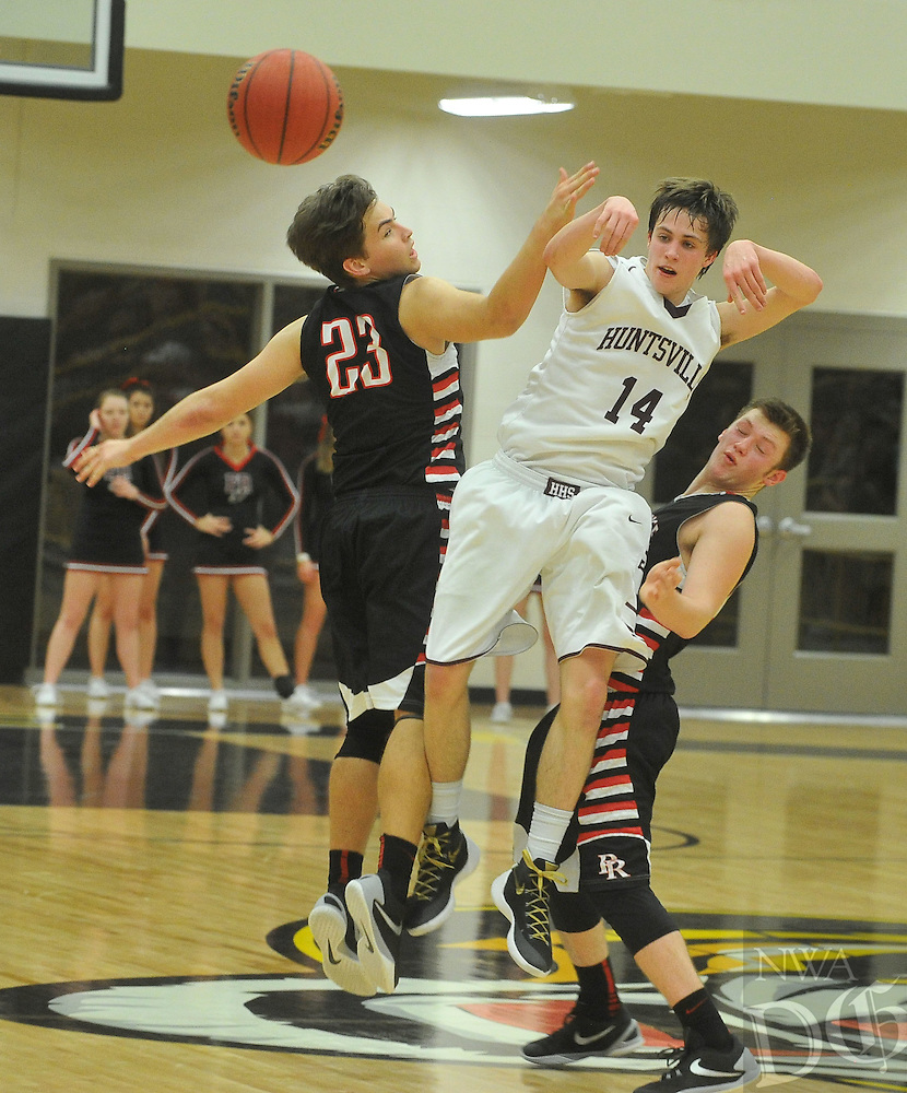 NWA Democrat-Gazette/MICHAEL WOODS • @NWAMICHAELW<br /> Huntsville's Jack Eaton (14) tries to get past Pea Ridge defenders Britton Caudill (23) and Westin Church (24)  during the boys 4A-1 District Tournament in Prairie Grove Saturday February 20, 2016.  Visit nwadg.com/photos to see more photographs from the game.