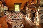 Camp Up-There, Elizabethtown, NY. Old Adirondack Bedroom with fireplace.