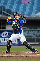 Catcher Evan Skoug (52) of Libertyville High School in Libertyville, Illinois playing for the Chicago Cubs scout team during the East Coast Pro Showcase on July 31, 2013 at NBT Bank Stadium in Syracuse, New York.  (Mike Janes/Four Seam Images)