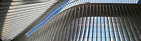 The partially finished World Trade Center Transportation Hub, known as the Oculus, opens to the public on Thursday, March 3, 2016. The over-budget, years late, $4 billion state-of-the-art transportation hub was designed by renowned architect Santiago Calatrava. When finished the hub will connect subway lines and PATH trains. Photo illustration using curved panorama. (© Richard B. Levine)