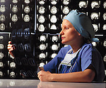 doctor reviews MRI scan of the brain