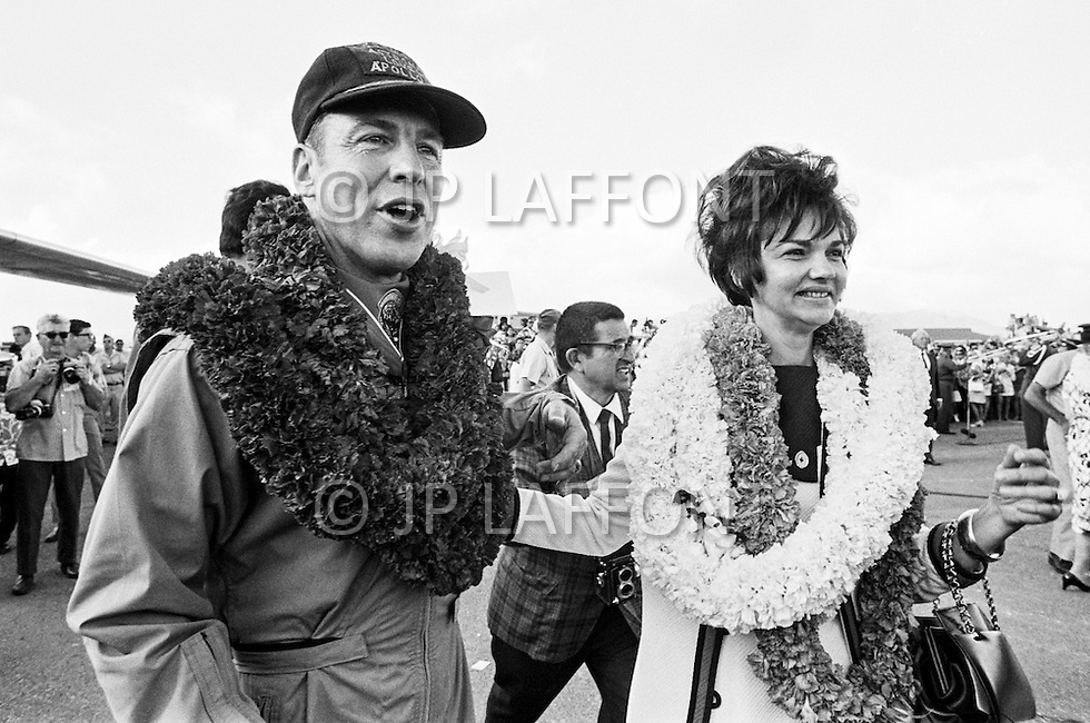18 Apr 1970, Honolulu, Oahu, Hawaii, USA --- Apollo 13 mission commander James Lovell walks with his wife following the return of the Apollo 13 crew in Honolulu. The mission was cut short due to an on board explosion, resulting in a forced splashdown in the Pacific Ocean. --- Image by © JP Laffont