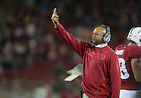 Stanford, Ca - Friday, August 31, 2012: Coach David Shaw signals the offense during Stanford's 20-17 win over San Jose State.