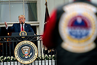 United States President Donald J. Trump speaks from the Blue Room Balcony of the White House during a Rolling to Remember ceremony honoring the nation's veterans and prisoners of war/missing in action (POW/MIA) in Washington, D.C., U.S., on Friday, May 22, 2020. Trump didn't wear a face mask during most of his tour of Ford Motor Co.'s ventilator facility Thursday, defying the automaker's policies and seeking to portray an image of normalcy even as American coronavirus deaths approach 100,000. <br /> Credit: Andrew Harrer / Pool via CNP /MediaPunch