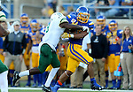BROOKINGS, SD - SEPTEMBER 17: Isaac Wallace #35 from South Dakota State University tries to slip the grasp of Kitu Humphrey #8 from Cal Poly in the first half of their game Saturday night at the Dana J. Dykhouse Stadium in Brookings. (Photo by Dave Eggen/Inertia)