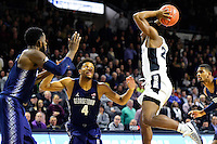 Wednesday, January 4, 2016: Georgetown Hoyas guard Jagan Mosely (4) defends against Providence Friars guard Kyron Cartwright (24) during the NCAA basketball game between the Georgetown Hoyas and the Providence Friars held at the Dunkin Donuts Center, in Providence, Rhode Island. Providence defeats Georgetown 76-70 in regulation time. Eric Canha/CSM