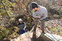 NWA Democrat-Gazette/FLIP PUTTHOFF <br /> Dalio Alarcon rapels down the 45-foot cliff helped Nov. 16 2018 by Eli Wadkins (cq) with Lewis and Clark Outfitters.