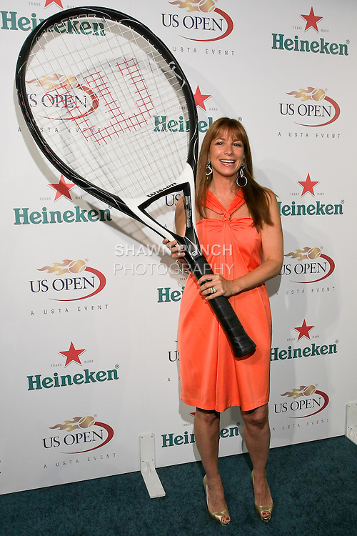 Jill Zarin hold hugh tennis racket at the US Open Player Party at The Empire Hotel, August 27, 2010.