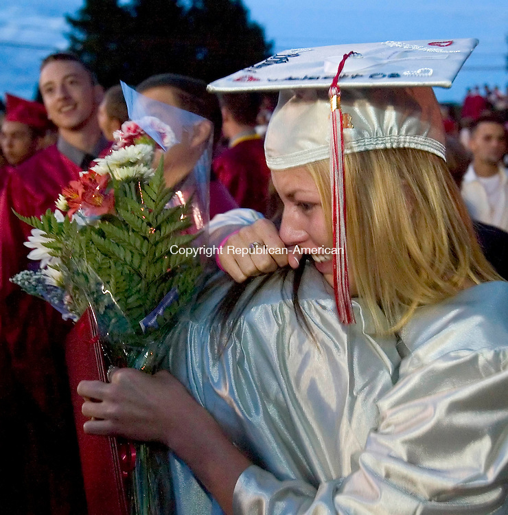 WOLCOTT, CT --JUNE 19, 2008-061908JS11-Wolcott High School graduate Brittany Mahoney, right, gives a tearful hug to fellow graduate Stephanie Anderson following Thurday's commencement exercises at the high school.<br /> Jim Shannon/Republican-American