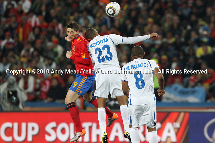 21 JUN 2010: Fernando Torres (ESP) (9) and Sergio Mendoza (HON) (23). The Spain National Team played the Honduras National Team at Ellis Park Stadium in Johannesburg, South Africa in a 2010 FIFA World Cup Group C match.