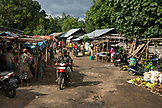 INDONESIA, Flores, husband and wife cruise through the Aimere market on their motorbike, Aimere