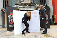 LOS ANGELES - MAY 15: Alwyn Hight Kushner, Britain's Consul General Michael Howells at an event to sign a wedding card as they Kick Off Hollywood's Salute To The Royal Wedding at TCL Chinese Theatre IMAX on May 15, 2018 in Los Angeles, California