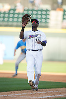 Winston-Salem Dash first baseman Keon Barnum (20) catches a foul pop fly during the game against the Myrtle Beach Pelicans at BB&T Ballpark on May 9, 2015 in Winston-Salem, North Carolina.  The Pelicans defeated the Dash 3-2 in 10 innings in the first game of a double-header.  (Brian Westerholt/Four Seam Images)