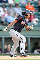 Infielder Cleuluis Rondon (5) of the Kannapolis Intimidators bats in a game against the Greenville Drive on Friday, April 11, 2014, at Fluor Field at the West End in Greenville, South Carolina. Rondon is the No. 26 prospect of the Chicago White Sox, according to Baseball America.  (Tom Priddy/Four Seam Images)