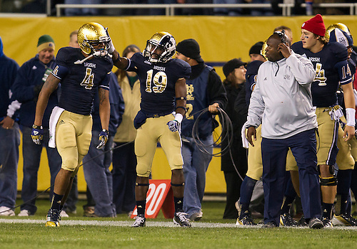 October 06, 2012:  Notre Dame running back George Atkinson III (4) and wide receiver Davonte' Neal (19) during NCAA Football game action between the Notre Dame Fighting Irish and the Miami Hurricanes at Soldier Field in Chicago, Illinois.  Notre Dame defeated Miami 41-3.