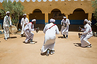 Merzouga, Morocco.  Gnaoua Musicians Performing Traditional Song and Dance with Krakeb and Drums.