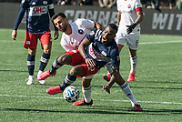 FOXBOROUGH, MA - MARCH 7: Cristian Penilla #70 of New England Revolution and Jonathan Bornstein #3 of Chicago Fire battle for the ball during a game between Chicago Fire and New England Revolution at Gillette Stadium on March 7, 2020 in Foxborough, Massachusetts.