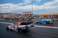 Jul 22, 2018; Morrison, CO, USA; NHRA funny car driver Robert Hight (near) races alongside Tommy Johnson Jr during the Mile High Nationals at Bandimere Speedway. Mandatory Credit: Mark J. Rebilas-USA TODAY Sports