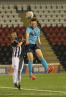 Chris Kane climbs above Jon Scullion to head away in the St Mirren v Dunfermline Athletic Scottish Professional Football League Under 20 match played at the Excelsior Stadium, Airdrie on 11.12.13.