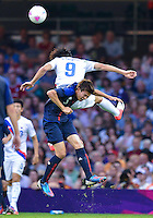 August 10, 2012..South Korea's Ji Dong-won and Japan's Takahiro Ohgihara in action during bronze medal match at the Millennium Stadium on day fourteen in Cardiff, England. Korea defeat Japan 2-0 to win Olympic bronze medal in men's soccer. ..