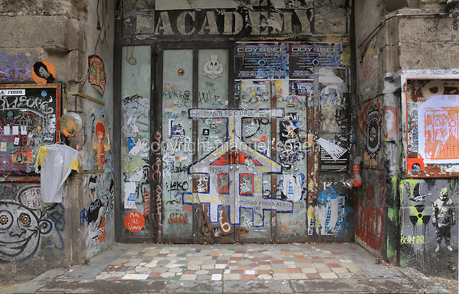 Graffiti on the closed doors of the Kunsthaus Tacheles, an art centre established in 1990 containing artists' studios, workshops, a nightclub and cinema, which was closed down in 2012 and is now derelict, Oranienburger Strasse, Mitte, Berlin, Germany. The building was originally a department store built 1907-8 in the Jewish quarter or Scheunenviertel. Picture by Manuel Cohen