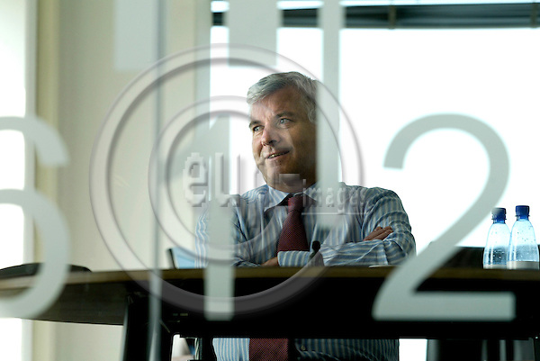 AMSTERDAM - BELGIUM - 04 JULY 2006 -- Anders MOBERG the CEO of Ahold, seen through a glass-wall in his office at the Royal Ahold's Headquarters (HQ). PHOTO: ERIK LUNTANG / EUP-IMAGES