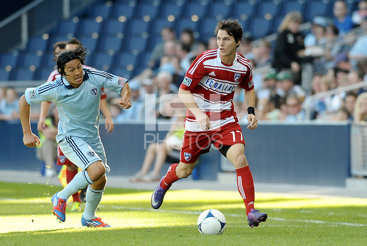 Zach Loyd (17) FC Dallas defender goes past Sporting KC midfielder Roger Espinoza... Sporting KC defeated FC Dallas 2-1 at LIVESTRONG Sporting Park, Kansas City, Kansas.