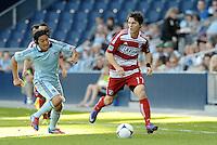 Zach Loyd (17) FC Dallas defender goes past Sporting KC midfielder Roger Espinoza... Sporting KC defeated FC Dallas 2-1 at LIVESTRONG Sporting Park, Kansas City, Kansas.