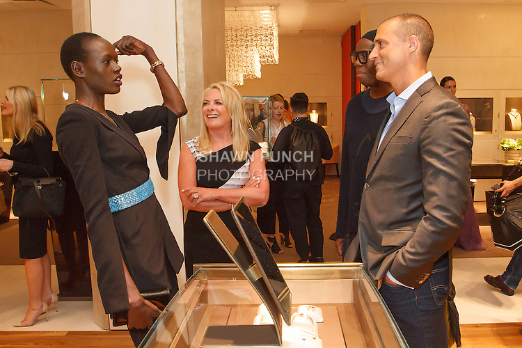 (Front from left to right) model Ajak Deng; fashion designer Pamella Roland;  runway coach Miss J Alexander; and photographer Nigel Barker laughing and talking during Pamella Roland Resort 2017 collection fashion presentation at Bvlgari located at 4 West 57 Street in New York City, on June 8, 2018.