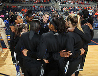 Duke teammates huddle during an NCAA college basketball game in Charlottesville, Va. Duke defeated Virginia 62-41...