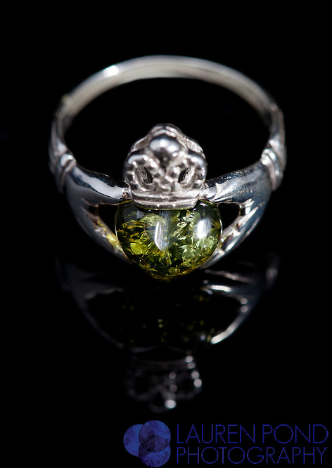 Jewelry ring green claddagh; amber collection